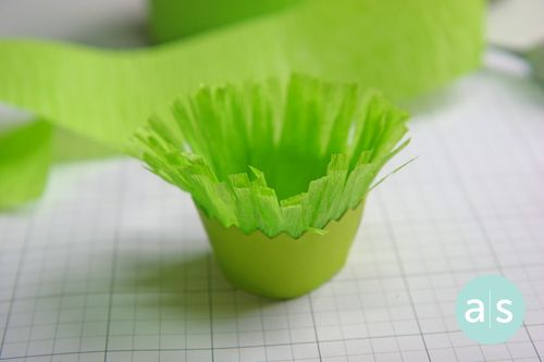 A Muse Studio cupcake wrapper with crepe paper cut