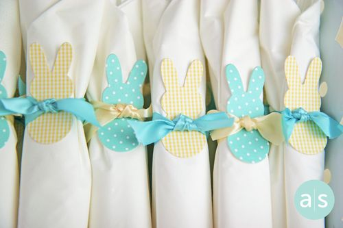 A Muse Studio Easter Napkin wraps with bunny and ribbon hor