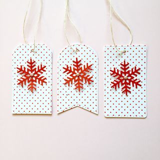 A Muse Studio Polka Dot Snowlfake Tags in a row