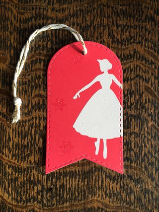 Red ballerina tag